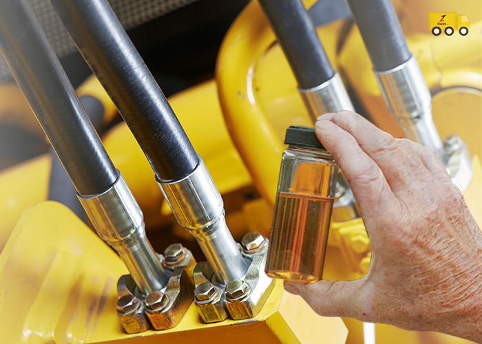 What functions do hydraulic oil perform in a system?
